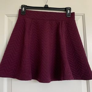 Maroon skater skirt with silver zipper Barely worn